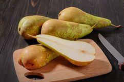 Pear conference on a dark wooden rustic background royalty free stock images