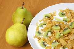 Pear and cornflakes Royalty Free Stock Photography