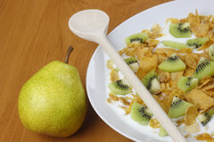 Pear and cornflakes Stock Photography