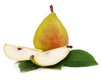 Pear with cut and green leaves isolated on white background. Royalty Free Stock Photography