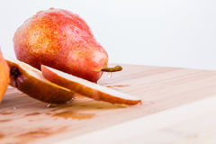 Pear on a cutting board. Made of bamboo Stock Images