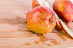 Pear on a cutting board. Made of bamboo Royalty Free Stock Image