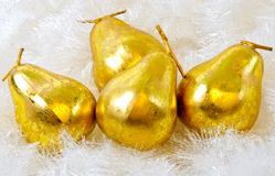 Pear Decorations. Pears among tinsel photographed in studio as christmas decorations Royalty Free Stock Image