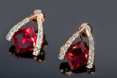 Pear Diamonds Earrings. red gems Royalty Free Stock Photography