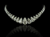Pear Diamonds necklace. A magnificent pear diamonds necklace on black background with reflection Stock Photography