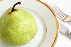 Pear for dinner Stock Image