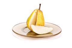 Pear on a dish Royalty Free Stock Image