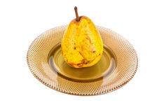 Pear on a dish Stock Images