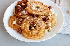 Fried pear donuts. Pear donuts with fried hazelnuts and ice cream royalty free stock photos