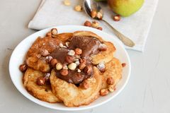 Fried pear donuts. Pear donuts with fried hazelnuts and ice cream royalty free stock image