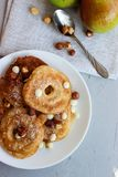 Fried pear donuts. Pear donuts with fried hazelnuts and ice cream stock images