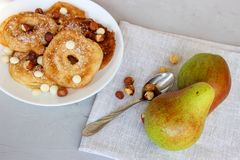 Fried pear donuts. Pear donuts with fried hazelnuts and ice cream stock photography