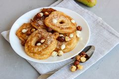 Fried pear donuts. Pear donuts with fried hazelnuts and ice cream stock photo