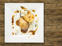 pear entirely with thyme and Gorgonzola cheese, old wood Stock Photography