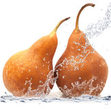 Pear falling in water Royalty Free Stock Photo