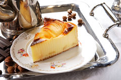 Pear flan on porcelian plate. With silver tray and pot Stock Photos