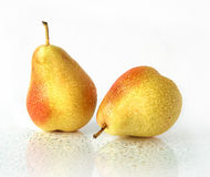 Pear fruit. Appetizing fruit of a pear on a light background Royalty Free Stock Image