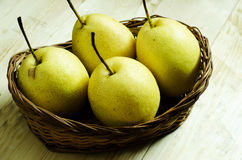 Pear fruit. Pears in a fruit basket Stock Image