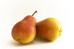 Pear Fruits. Two Pear Fruits lying together on white background stock photos