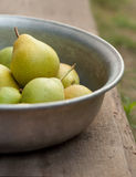Pear fruits in bowl Stock Photos