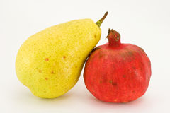 Pear and garnet isolated. On white background Royalty Free Stock Images