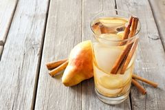 Pear, ginger, cinnamon detox water against rustic wood Stock Images