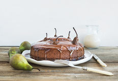 Pear, ginger and honey cake with creamy caramel topping, fresh p Stock Photo