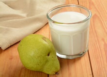 Pear and glass of milk Royalty Free Stock Photos