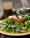 Pear and Gorgonzola Salad. Plated Pear and Gorgonzola Salad with vinigrette dressing Royalty Free Stock Image