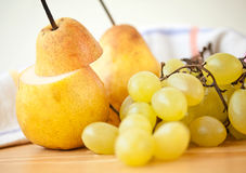 Pear and grape fresh fruit Royalty Free Stock Image
