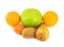 Pear grapefruit oranges Royalty Free Stock Image