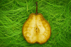 Pear on grass Stock Image