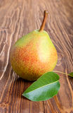 Pear with green leaf Royalty Free Stock Image