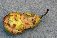 Pear half eaten Royalty Free Stock Photography