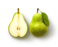 Pear and half Pear. Pear with leaf and pear half over white royalty free stock image