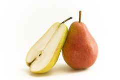 Pear with halve. Pear and halve standing upright stock photo