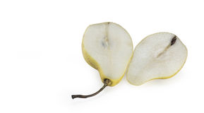 Pear halves. Pear cut in the middle on white background royalty free stock image