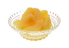 Pear halves in glass dish. A clear glass bowl filled with pear halves on a white background Stock Photo