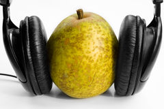 Pear in headphones Royalty Free Stock Photo