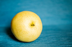 Pear isolated on table cloth. Juicy pears isolated on blue table cloth fabric Stock Photo