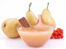 Pear jam. Bowl of pear jam and some fresh pears Royalty Free Stock Photos