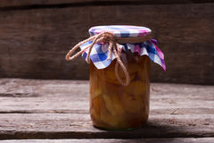 Pear jam on the old wooden background. Royalty Free Stock Photo