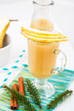 Pear juice with cinnamon. Decorated with fir branches Royalty Free Stock Images