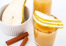 Pear juice with cinnamon in a glass Stock Images