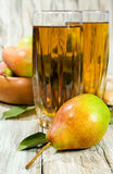 Pear juice with fresh fruit Stock Photography