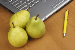 Pear and laptop Stock Photo