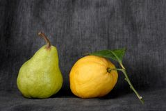 Pear and lemon Stock Images