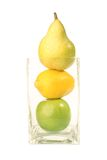 Pear, Lemon, Apple isolated. A stack of fruits including pear, lemon and apple royalty free stock photography