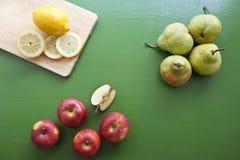 Pear, lemon, apple - mix of fruits for fresh juice Royalty Free Stock Photo