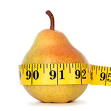 Pear with measure tape Royalty Free Stock Photos